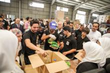 H.R.H Crown Prince Al Hussein Bin Abdullah packing during a volunteer initiative to send aid through The Hashemite Charitable Organization Humanitarian Aid to Gaza