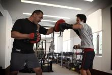 H.R.H. Crown Prince Al Hussein Bin Abdullah II during boxing practice with Jordanian Boxing Champion, Mohammed Abu Khadeja, Spring 2013