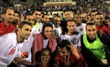 H.R.H. Crown Prince Al Hussein Bin Abdullah II with Al-Nashama, Jordan's national football team, after attending the Jordan vs. Oman football match 18th June, 2013