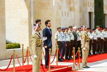 His Majesty the Supreme commander of Jordanian Armed Forces, Accompanied by Her Majesty Queen Rania Al Abdullah and HRH Crown Prince Al Hussein, hands the Hashemites flag the Chairman of the Joint Chiefs of Staff, Gen. Mashal Mohammad Zaben 9/6/2015