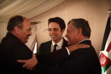 H.R.H. Crown Prince Al Hussein bin Abdullah II with His Majesty King Abdullah II ibn Al Hussein greet a guest during a Ramadan Iftar, July 2013
